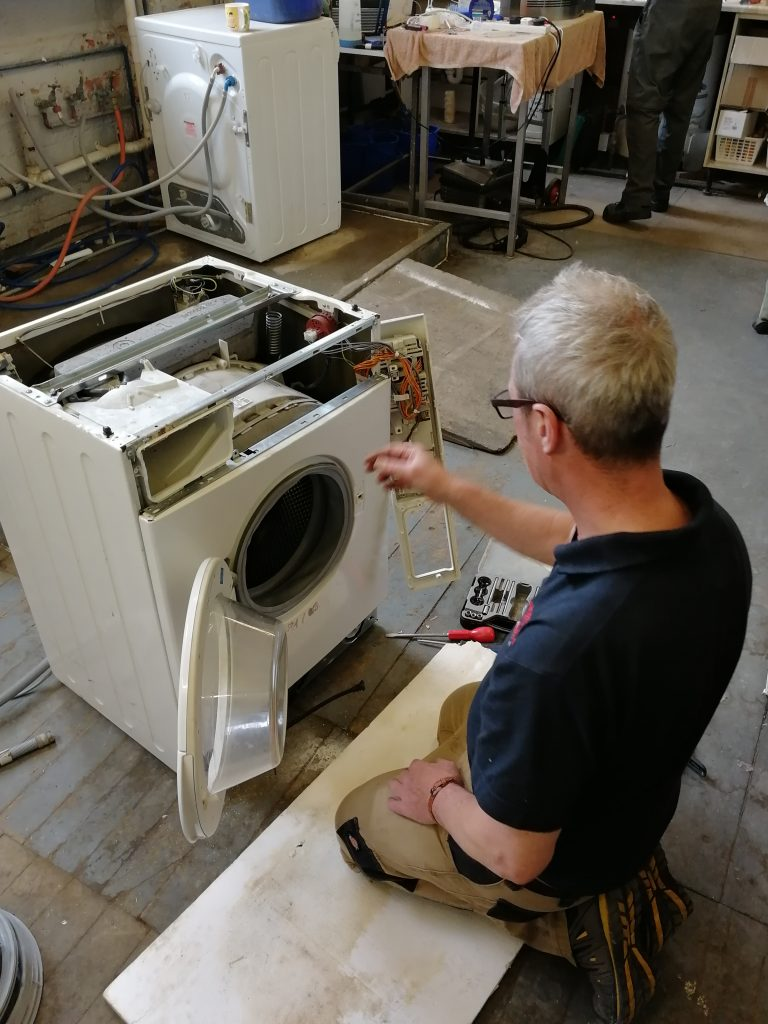 Engineer PAT testing a Washing Machine
